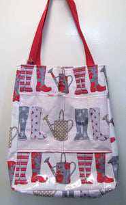 Beautiful handcrafted wellie themed wax fabric wellie bag with two handles