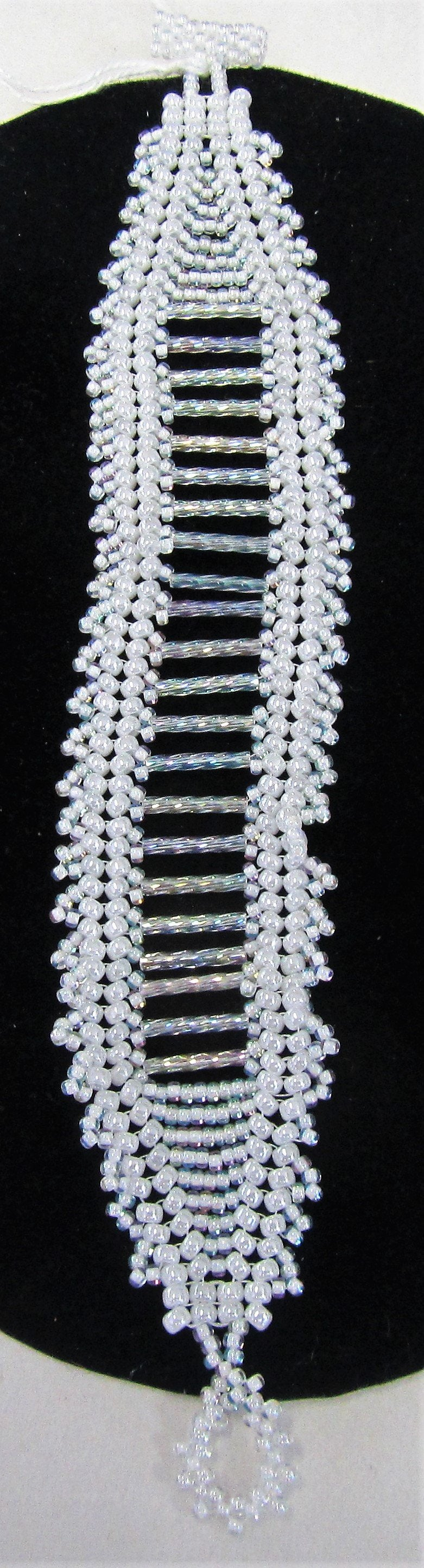 Beautiful handcrafted bracelet with white beads, fastened with a toggle clasp