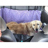 dog riding in car hammock