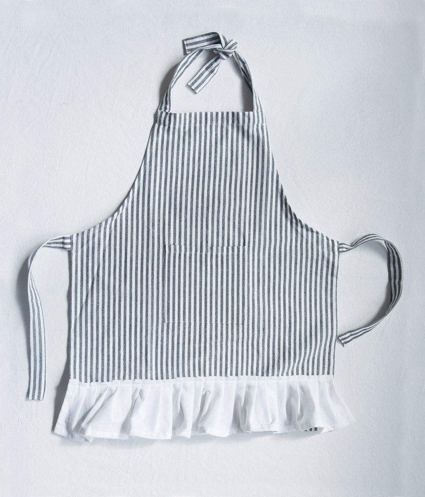 cotton woven child's apron with pocket and ruffle in black and cream stripe