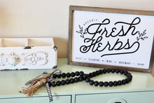 Load image into Gallery viewer, farmhouse wood bead garland in black with buffalo check ribbon and tassels