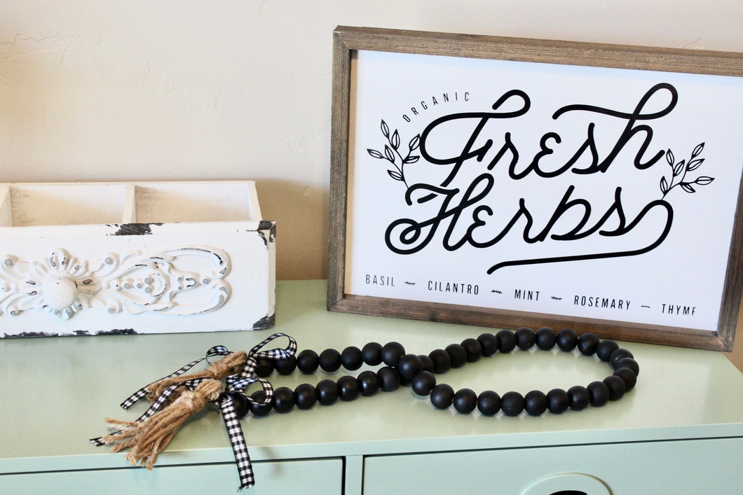 farmhouse wood bead garland in black with buffalo check ribbon and tassels
