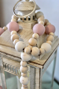Farmhouse bead garland in pink, cream and natural colors. Bead sizes vary