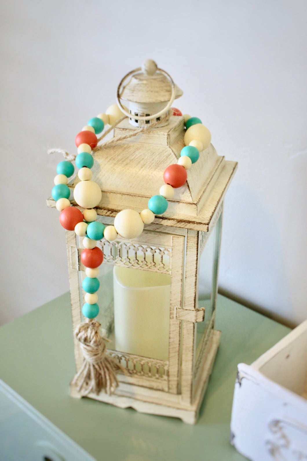 Summer Taffy Wood Bead garland with tassel and loop for hanging. Comes in a coral, cream and mint colored beads