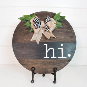 HI Wood Round Sign stained dark and embellished with a burlap and ribbon bow and green leaves