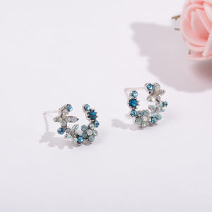 Rhinestone hoop earrings with floral embellishment