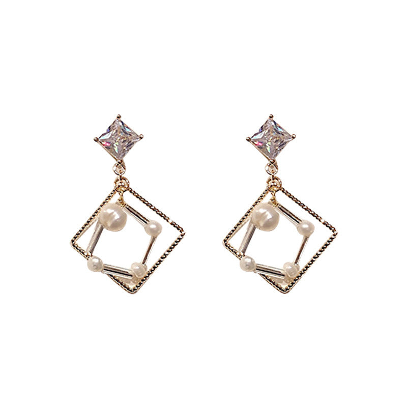 Structure rhinestone stud earrings with pearl embellishment