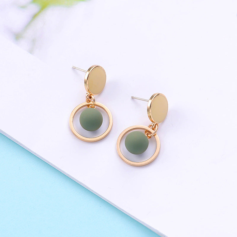 Study earrings with green pendants and gold hoop