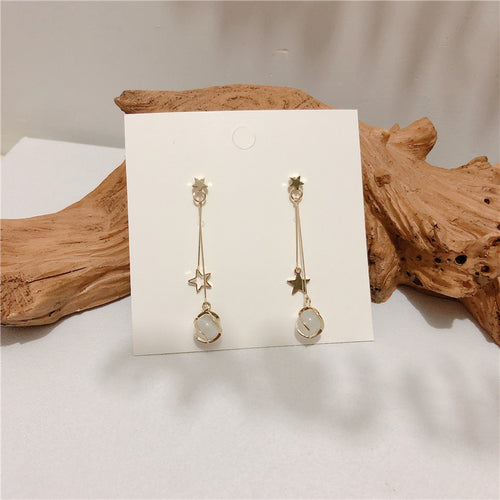 Star design drop earrings with resin stone