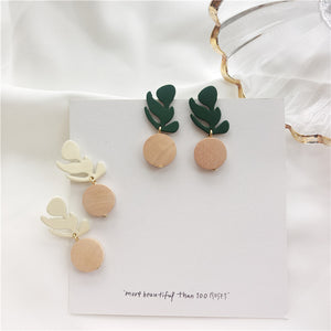 Wooden drop earrings in leaf shape