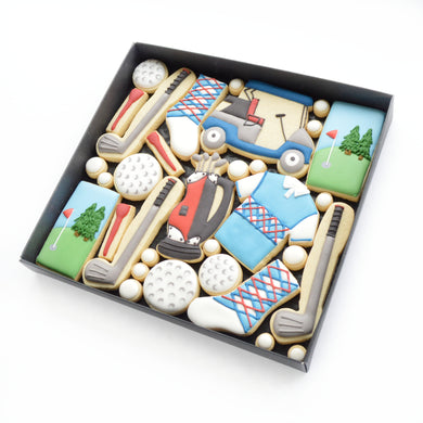 golf themed hand iced biscuits by katies biscuit shop