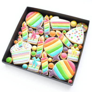 fun rainbow birthday theme hand iced biscuits by katies biscuit shop