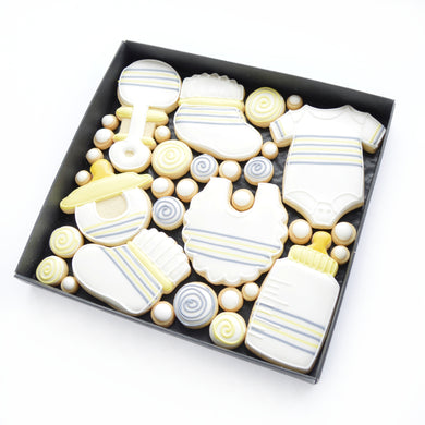 new baby theme yellow and grey hand iced biscuits by katies biscuit shop