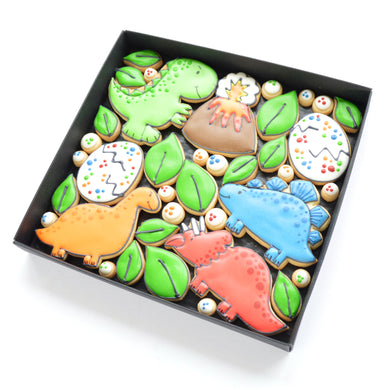 dinosaur themed hand iced biscuits by katies biscuit shop