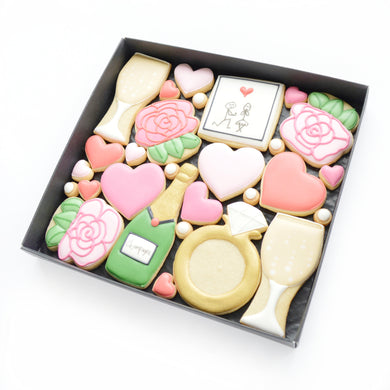 engagement themed hand iced biscuits by katies biscuit shop