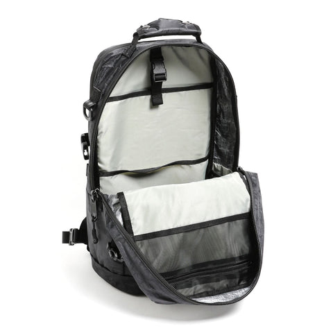 "{""color"":""Black"",""alt"":""Descente x DSPTCH Weekender Backpack with the interior opened so that you can see the inside of the bag""}"