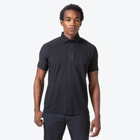 "{""caption"":""Model is 6'0\"", 32\"" Waist, Size Medium"",""color"":""Black"",""alt"":""Men's ALLTERRAIN Seamless Stretch Polo On Model Front View""}"