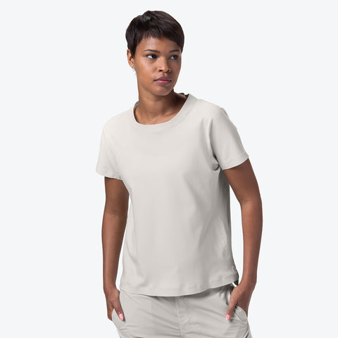 "{""caption"":""Model is 5'8\"", Size Small"",""color"":""White Ecru"",""alt"":""Women's ALLTERRAIN Seamless Stretch Tee On Model Front View""}"