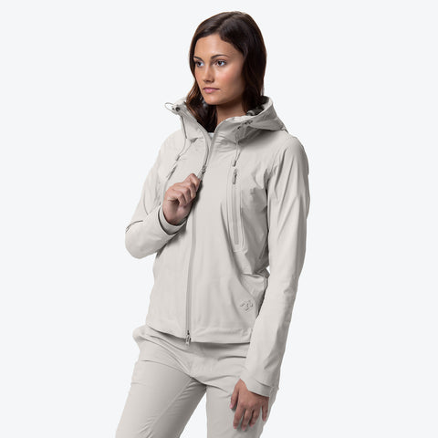 "{""caption"":""Model is 5'8\"", Size Small"",""color"":""White Ecru"",""alt"":""Women's ALLTERRAIN Creas Hard Shell Jacket On Model Side View""}"
