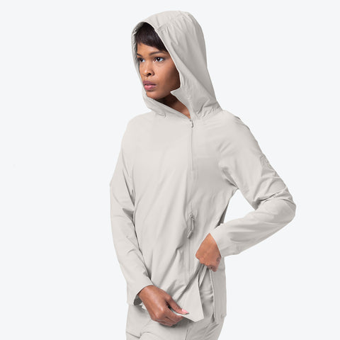 "{""caption"":""Model is 5'8\"", Size Small"",""color"":""White Ecru"",""alt"":""Women's ALLTERRAIN Parahem Packable Hooded Jacket On Model Side View Unzipping Lower Side Zipper""}"