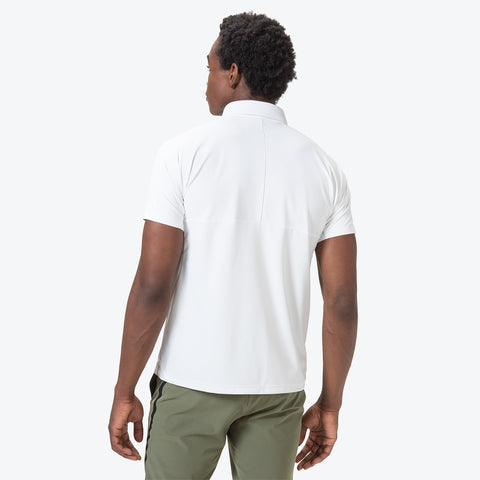 "{""caption"":""Model is 6'0\"", 32\"" Waist, Size Medium"",""color"":""White"",""alt"":""Men's UV Protection Short Sleeve Polo on model from the back in white""}"