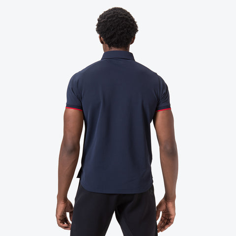 "{""caption"":""Model is 6'0\"", 32\"" Waist, Size Medium"",""color"":""Navy""""alt"":""TOUGH Move Sport Polo on model from the back in navy""}"