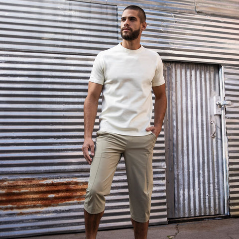 "{""caption"":""Model is 5'11\"", 31\"" Waist, Size Medium"",""color"":""Beige"",""alt"":""Cropped Commuter Pants Shown on Model in Khaki with the SYNCHKNIT Capture Shirt""}"