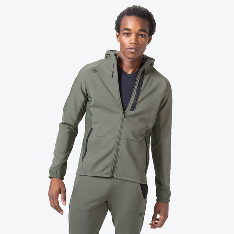 "{""caption"":""Model is 6'0\"", 32\"" Waist, Size Medium"",""color"":""Khaki"",""alt"":""Technista Stretch Jacket on model from the front""}"