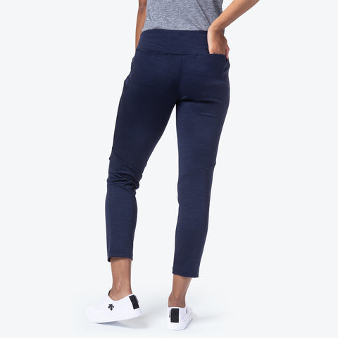 "{""color"":""Navy"",""alt"":""Women's Manerd Wool Slim Fit Pants in graphite navy on model back view. Model has hand in back pocket casually.""}"