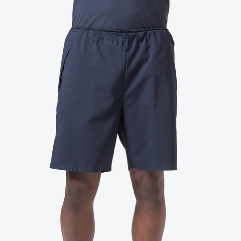 "{""caption"":""Model is 6'0\"", 32\"" Waist, Size Medium"",""color"":""Graphite Navy"",""alt"":""Men's Utility Training Shorts on model from the front in graphite navy""}"