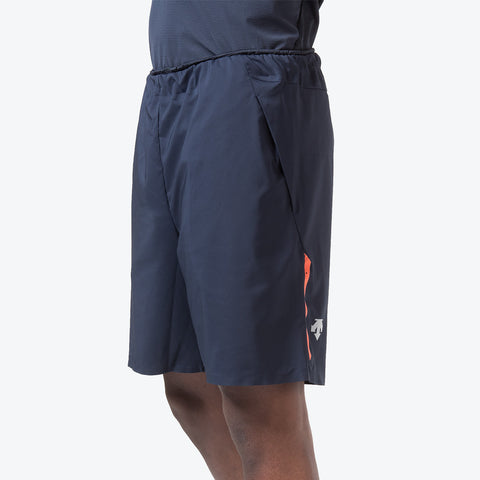 "{""caption"":""Model is 6'0\"", 32\"" Waist, Size Medium"",""color"":""Graphite Navy"",""alt"":""Men's Utility Training Shorts on model from the side in graphite navy""}"