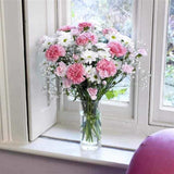<p>A simple collection of pink long stemmed standard carnations, white spray chrysanthemums, white spray carnations, pink spray carnations and gypsophila combine to made this attractive display.</p><p>Expertly hand-tied this simple arrangement is sure to impress and is guaranteed to last.</p>