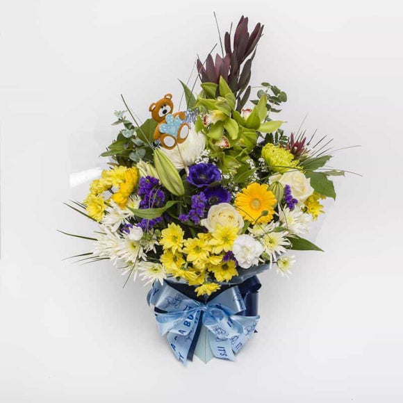 <p>Congratulate the proud parents with a delightful bouquet in shades of blue and white. Makes a beautiful gift to celebrate the birth of a baby boy. Wrapped up in baby blue netting and including Baby Boy Decorations.</p>