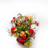 <p>A sensational assortment of crimson roses, star shaped asiatic lilies, chrysanthemums, carnations and seasonial winter foliage.</p><p>We have expertly hand-tied them and beautifully wrapped in seasionally decorative material, to create a gorgeous Christmas Gift!</p>