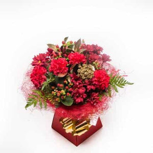 <p>We have created a beautiful blend of vibrant Red Carnations, Red Chrysanthemum and seasonal berries in a warm red sisal seasonal red bouquet box in this festive treat.</p><p>Filled with seasonal warm colours this gorgeous gift is sure to brighten your home and spread the seasons good will! </p>