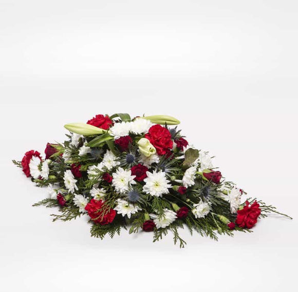 <p>This Classic Spray is pointed at both ends and is approximately 60cm long (2 feet)</p><p>Can be customised to be colour appropriate to suit a lady or a gent. Contains several Lilies as well a range of fresh Chrysanthemums and Carnations expertly arranged. Perfect for an anniversary, month mind or a birthday. </p><p>If particular colours or flowers are required simple request them during the checkout stage.</p><p> </p><p> </p>