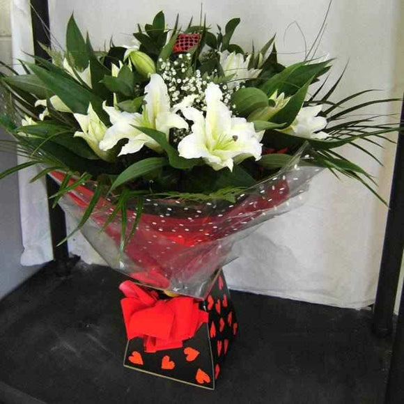 <p>A gorgeous collection of the finest large headed long stemmed Orential Lilies, hand-tied with Gypsophila and Tropical Foliage.</p><p>Traditionally lilies represent innocence and purity with the more modern connotations being honour and aspiration!</p><p>Beautifully wrapped in seasonial wrapping and beautifully presented in a presentation box, an outstanding gift!</p>