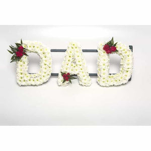 "<p>A fitting tribute to a much missed Dad. This stand out tribute is created using a mass of white double chrysanthemums and finished with a small ""spray"" of red roses on one corner of each letter.</p><p>Each letter measures approximately 30cm high and approximately 15 wide.</p><p>If you would like this done in different colours please contact us.</p>"