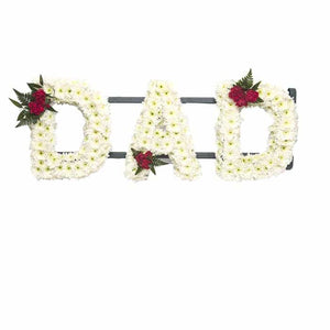 <p>Create your own personal name or message, for a personal tribute during a time of grief and remembrance. Each letter measures approximately 30cm high and 15cm wide.</p><p>Finished normally using a mass of white double chrysanthemums and detailed using roses.</p><p>Contact us directly to discuss your exact requirements, we stock a complete range of frames and can create any text you require </p>