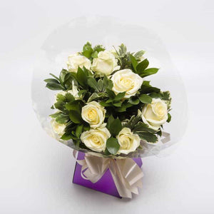 <p>Sending a Dozen Roses says it all! Express just how you feel to someone special with one dozen roses! </p><p>White roses are traditionally associated with marriages and new beginnings, their quiet beauty has also made them a gesture of remembrance. A bouquet of white roses is a prefect way to say - i'm thinking of you!</p><p>We expertly hand-tie these stately roses with brilliant white Gypsophila and tropical foliage, wrap them and present them in a gorgeous presentaion box for the world to enjoy.</p>