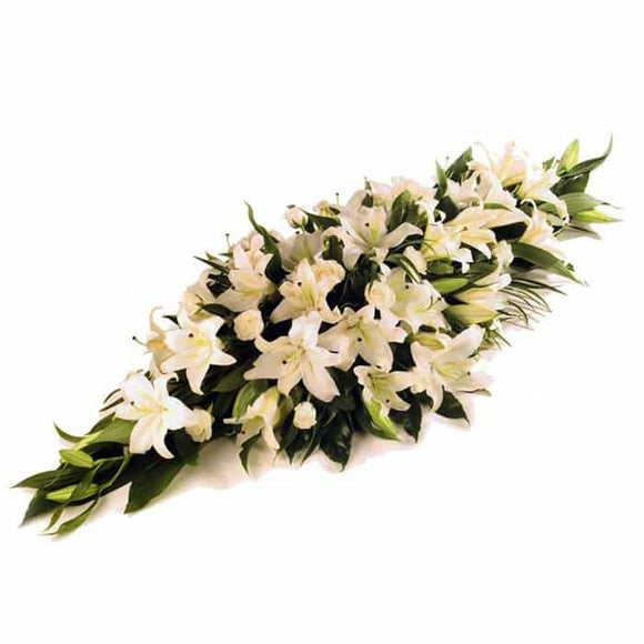 <p>An abundance of lilies create this striking but simple centrepiece.</p><p>Expertly arranged with the freshest of Lilies to create a memorable desplay on one of the saddest days.</p><p>Different colours and sizes can be arranged if required, simply contact us</p>