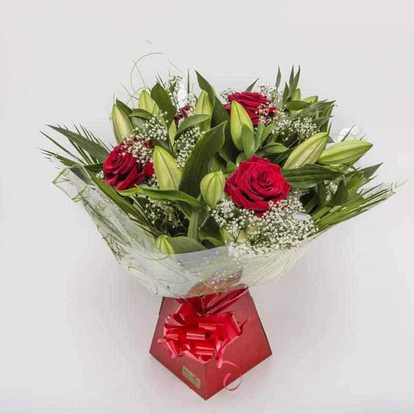 <p>The Best of Both Worlds, if your unsure which to buy simply buy both!</p><p>Gorgeous Red Velvet smooth long stem Gran Prix Roses and luxurious Orential Lilies expertly hand-tied, wrapped in seasonial wrapping and skillfully presented in a proud presentation box create this superb gift.</p><p>Ideal for all occasions.</p>