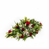 "<p>A beautiful arrangement expertly crafted using the finest ""Gran Prix"" Red Roses and classic White Orential Lilies.</p><p>Sitting approximately 60cm long (2 feet) long this tribuate is ideal for remembrance of a birthday, anniversary or funeral.</p>"