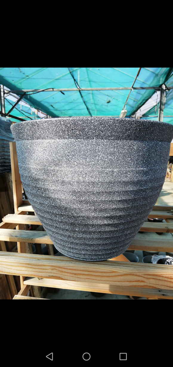 Grey speckled plastic pot
