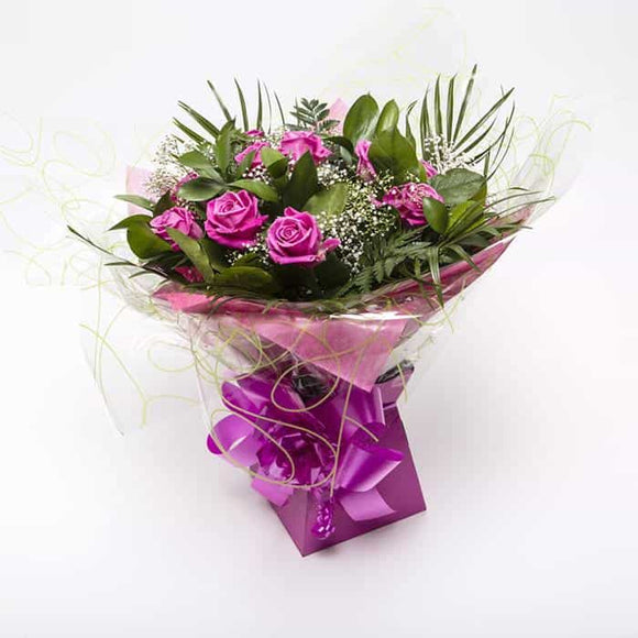 <p>Sending a dozen Roses says it all, Express just how you feel to someone special with one dozen roses. Tradationally pink roses are said to show thankfulness, admiration and happiness.</p><p>Expertly blended by our expert florists with Gypsophila and tropical foliage these beautiful roses are hand-tied and wrapped in seasonial wrapping and placed in a presentation box for all to enjoy.</p>