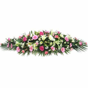 <p>A mixture of your choice of flowers expertly arranged will personalise this emotional centrepiece, Contact us directly to discuss your exact requirements. Ranges of colours and flower types can be suited to each individual customer.</p>