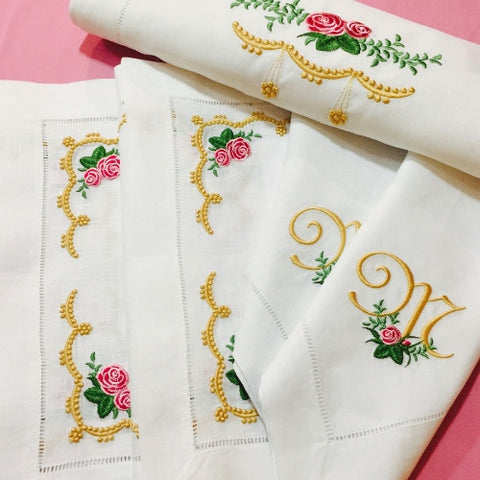 Embroidered table runners, placemats, and napkins
