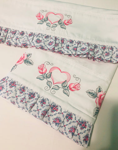 bed sheets embroidered with roses