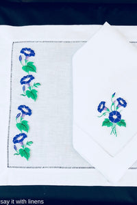 matching placemat and dinner napkin embroidered with morning glory flower desing