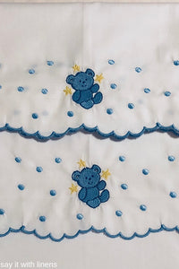 crib sheets embroidered with a bear design